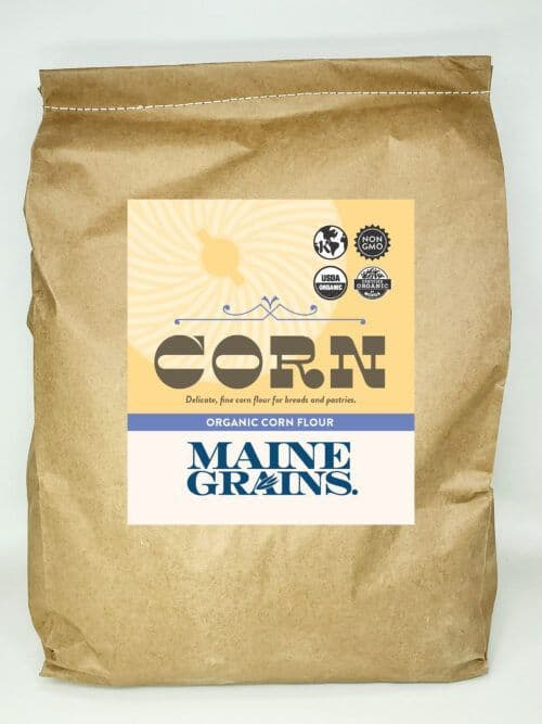 A 25# bulk bag of corn flour in a kraft paper bag.