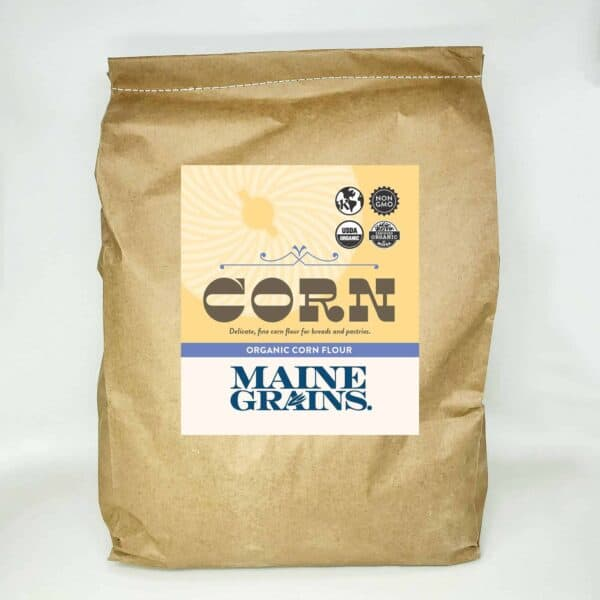 A 25# bulk bag of corn flour in a kraft paper bag.