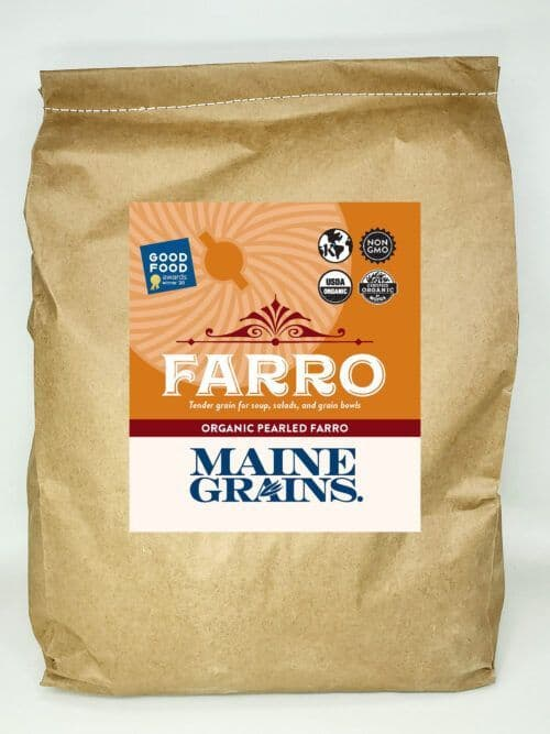 A 25# bulk bag of pearled farro in a kraft paper bag.