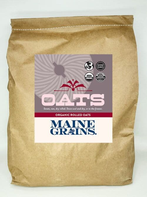 A 20# bulk bag of rolled oats in a kraft paper bag.
