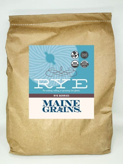 A 25# bulk bag of rye berries in a kraft paper bag.
