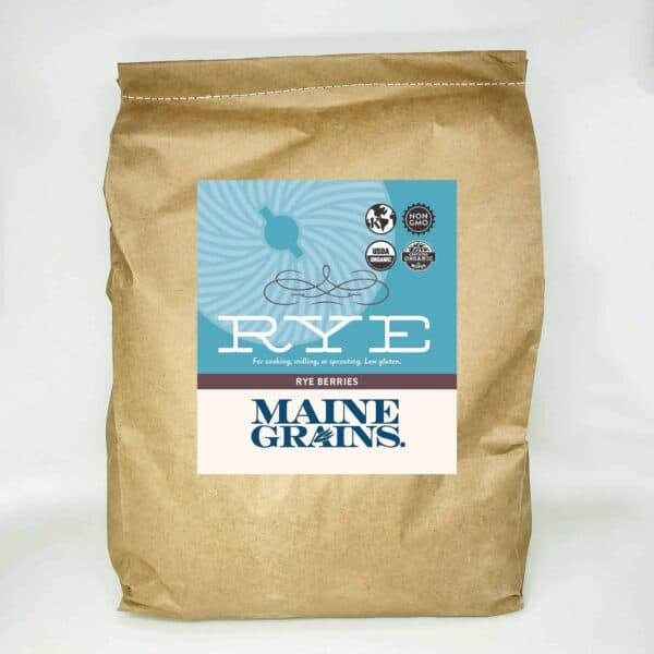 A 25# bulk bag of rye berries in a kraft paper bag.