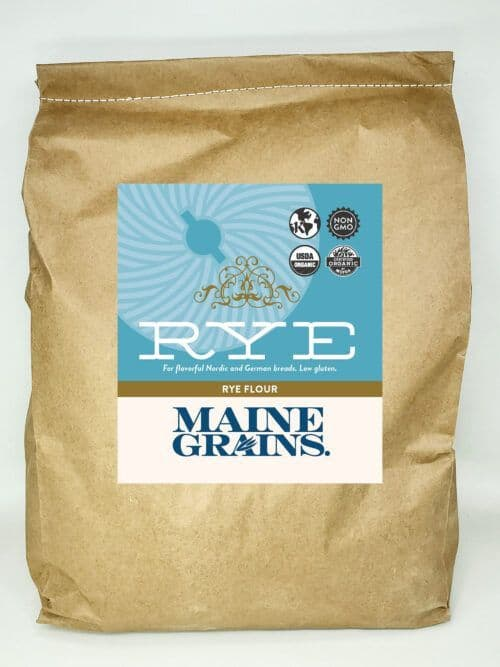 A 25# bulk bag of rye flour in a kraft paper bag.