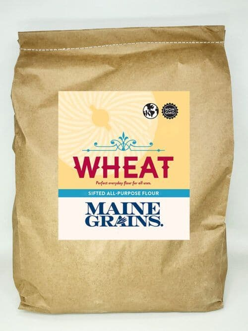 A 25# bulk bag of sifted wheat flour in a kraft paper bag.