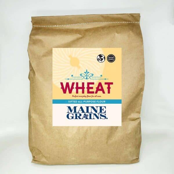 A 25# bulk bag of sifted wheat flour in a kraft paper bag.