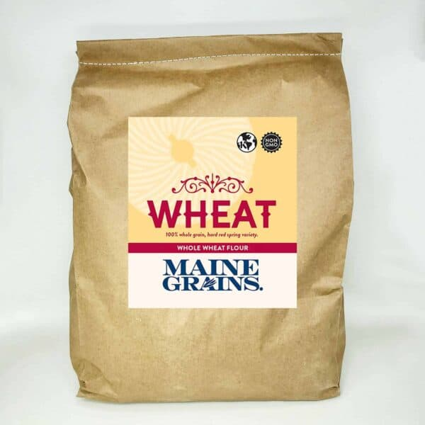 A 25# bulk bag of whole wheat flour in a kraft paper bag.